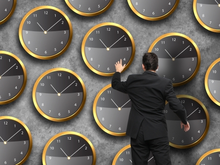 Businessman standing - time strategy concept in color Stok Fotoğraf