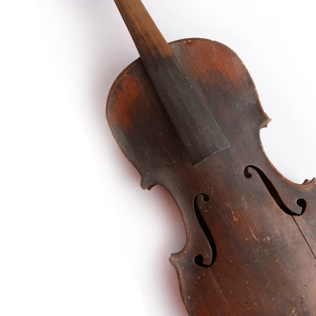 performing: Old broken violin isolated on the white background
