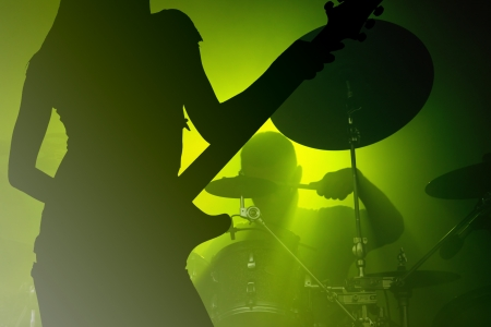 Rock band performing live show photo