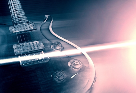 heavy metal music: Electric guitar and ray of light concept