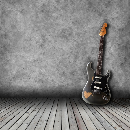 Electric guitar in the empty room Stock Photo
