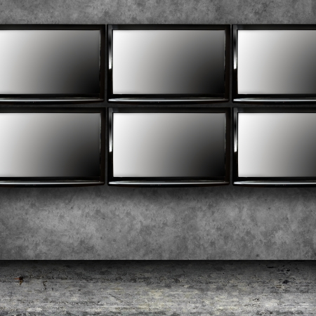 Set of modern TVs on the wall photo