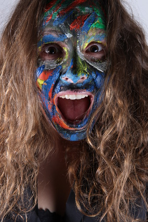 faceart: young woman with face-art and scaty expression