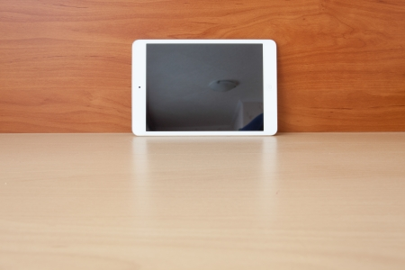 Tablet on the table with blank screen photo