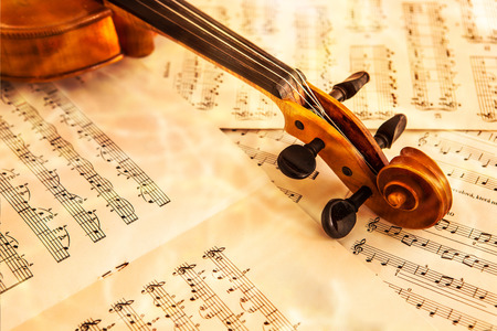 Old violin lying on the sheet of music, music concept Stok Fotoğraf - 25635671