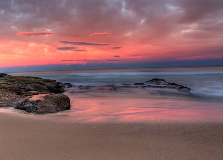 Sea stones at sunset - Sydney Australia photo