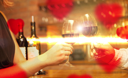 Valentines Day concept couple having dinner and drinking wine photo