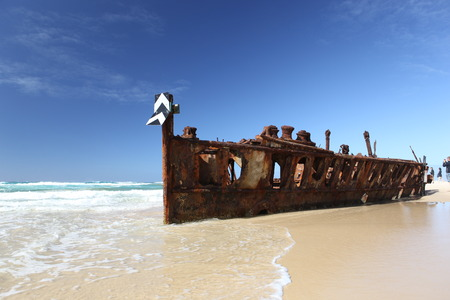 Rusty shipwreck on tropical beach - the Maheno, Fraser Island, Queensland, Australia photo