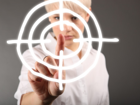Business strategy concept with dartboard and woman