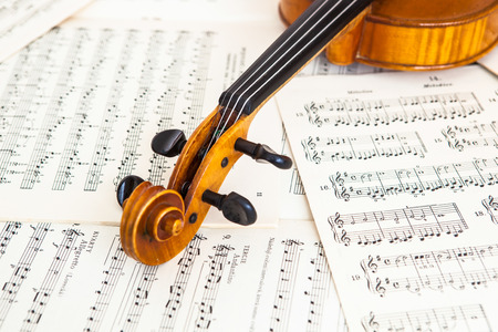 Old violin lying on the sheet of music, music concept Stok Fotoğraf