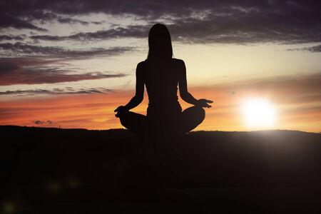 Yoga practicioner during the sunset meditation photo