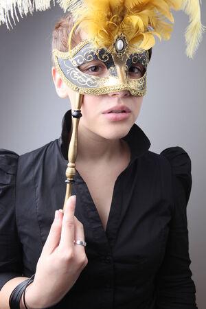 fetishes: Elegant girl with a wonderful mask studio shot