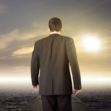 Businessman walking on journey to success as a business metaphor for entrepreneurship photo