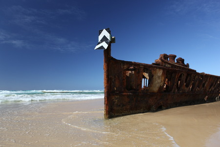 Rusty shipwreck on tropical beach - the Maheno, Fraser Island, Queensland, Australia photo