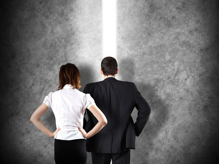 Business leadership concept with a businessman opening a straight path to success photo