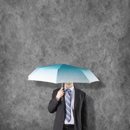 Umbrella background business concept with businessman photo