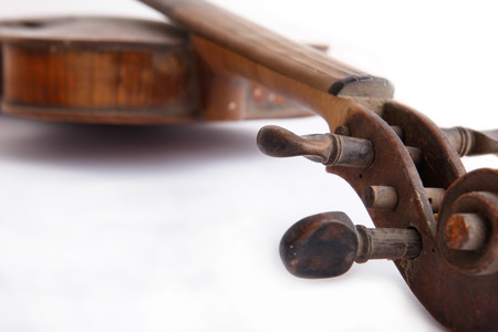 arts culture and entertainment: Old broken violin isolated on the white background