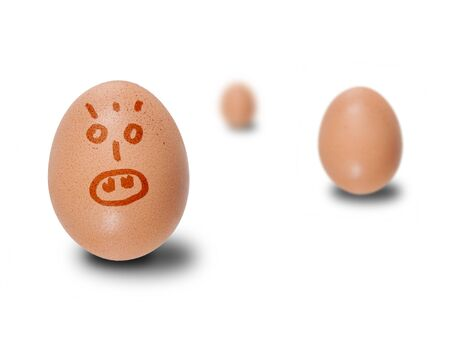 small group of objects: Brown eggs with faces drawn at surface