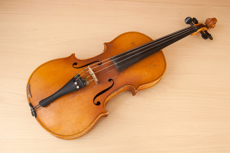 old desk: Old violin music concept lying on wood desk