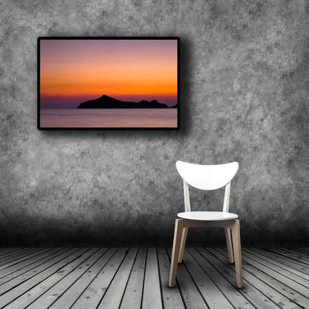 Plasma TV on the wall of the room with wooden floor and empty chair