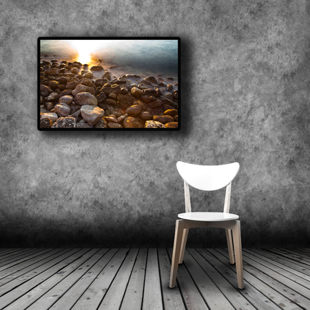 plasma tv: Plasma TV on the wall of the room with wooden floor and empty chair