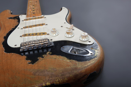 relic: Heavy Relic Vintage electric guitar on grey background Stock Photo