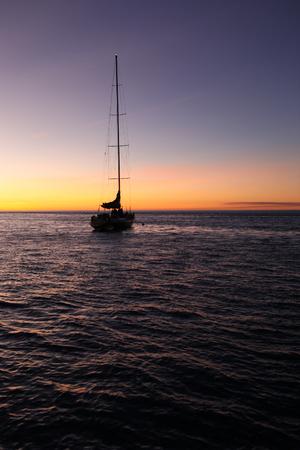 whitsundays: Beautiful sunset with blue sea and sky during boat trip at Whitsundays Island, Australia
