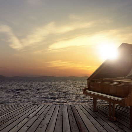 Piano outside shot at sea side during sunset
