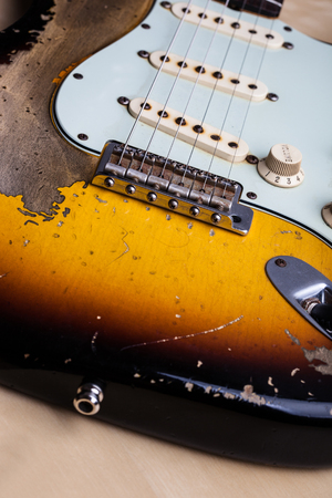 relic: Vintage Heavy Relic Electric Guitar Close up Stock Photo