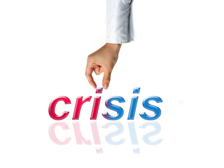 political and social issues: Hand and word crisis business concept on white background Stock Photo