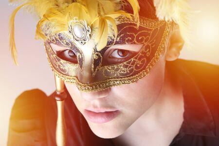 Elegant girl with a wonderful mask portrait photo