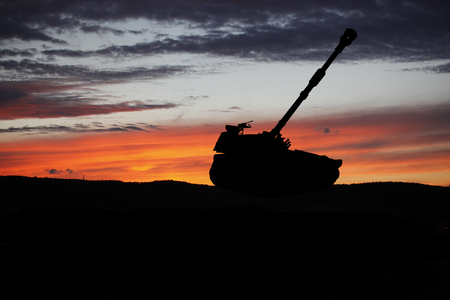 War Concept. Military tank silhouette scene on sky background, World War below Cloudy Skyline At night. Attack scene. Tanks battle