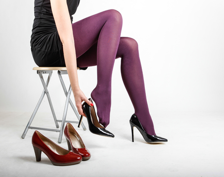 Woman's Legs Wearing Pantyhose and High Heels with space for text Banco de Imagens