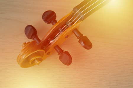 Old violin lying on the table, music concept Stock Photo