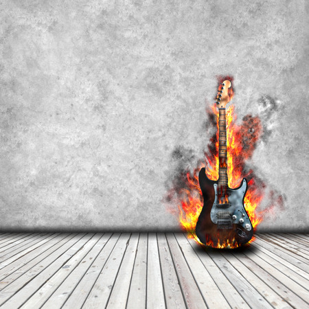 Burning guitar in the room with wooden floor