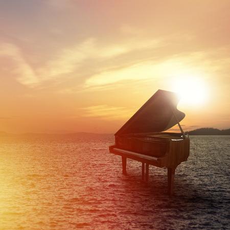 piano tir en plein air à la plage pendant le coucher du soleil