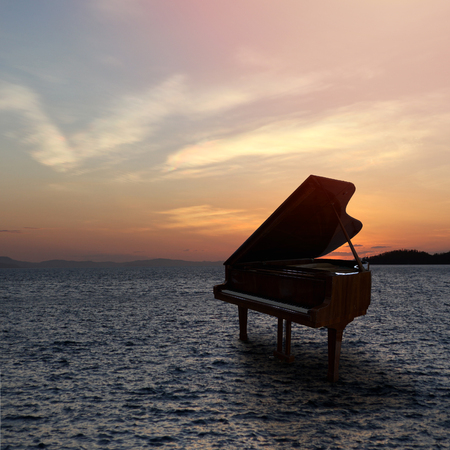 Piano outside shot at beach during sunset Stockfoto - 101191308