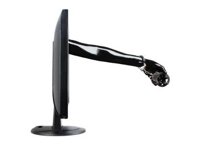 Porn addiction concept with latex arm from computer