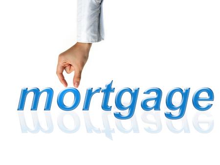 Female hand holding mortgage word, white background Stok Fotoğraf
