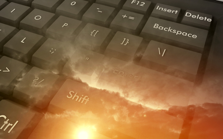 Keyboard at the sunset with clouds, abstract background