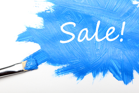 Sale concept painted by brush in blue Stok Fotoğraf