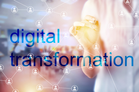 Digital Transformation Concept with Businesswoman touching screen