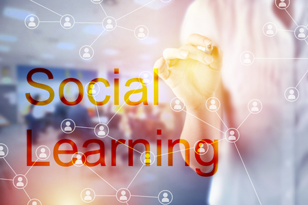 Social learning concept with businesswoman touching social network diagram