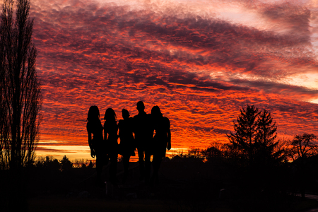 People celebrating during sunset - outdoor scene with silhouettes Stok Fotoğraf