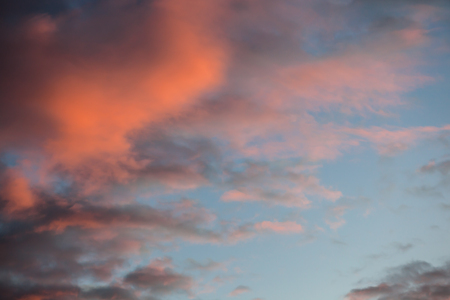Beautiful and dramatic red clouds sky at sunset in the evening Stok Fotoğraf
