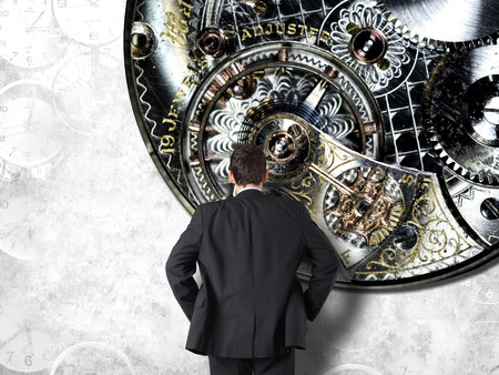 Concept of time with businessman in suit and clock