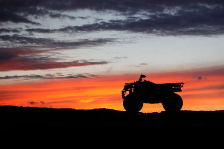 Silhouette ATV or Quad bike in the sunset. Holiday exploration concept with silhouette of quad bike Reklamní fotografie