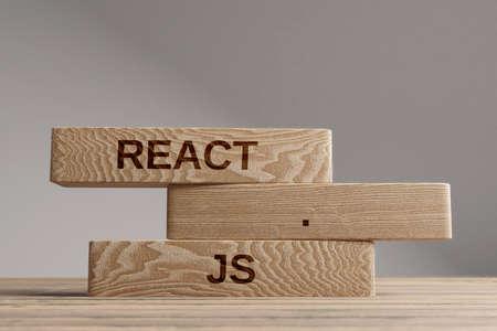 React js wooden blocks balance concept. Wooden concept
