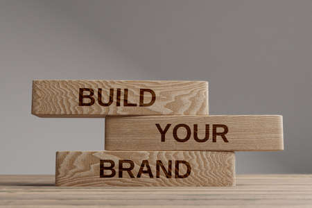 Build your brand wooden blocks balance concept. Wooden concept Stock Photo