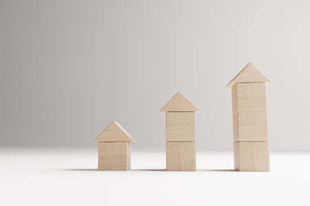 Real estate investment concept with wooden cubes , house selection concept, 3D rendering